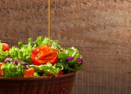 fresh-salad-wooden-table-scaled-260x188.jpg